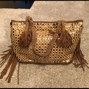 Tan suede hobo bag with silver coins and fringe